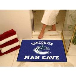 "Click here to learn more about the Vancouver Canucks Man Cave All-Star Mat 33.75""x42.5""."